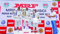 Karminder Pal Singh (centre), Dhruv Mohite (right) and Sourav Bandyopadhyay celebrate on the podium on Sunday.