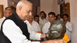 Senior BJP leader Yashwant Sinha pays floral tribute to Jai Prakash Narayan at his house before attending the first session of Rashtra Manch in Patna on Saturday. PTI Photo