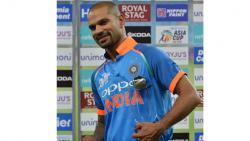 "India's batsman Shikhar Dhawan poses with the ""player of the match"" Cup after their win over Hong Kong in their one day international (ODI) Asia Cup cricket match between Hong Kong and India at the Dubai International Cricket Stadium in Dubai on Wednesday"