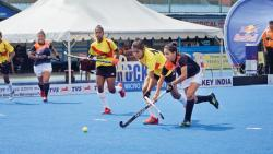 A match in progress between Hockey Maharashtra (in blue) and Hockey Karnataka.