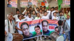 Congress workers display placards to celebrate the appointment of senior Congress leader and MP Kamal Nath as party's poll-bound Madhya Pradesh unit President at PCC headquarters in Bhopal on Thursday. PTI Photo