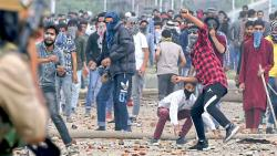 Youths clash with government forces on the outskirts of Srinagar on Saturday