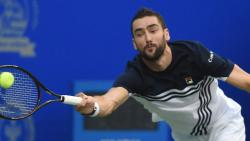 Croatian tennis player Marin Cilic plays a shot against French tennis player Pierre-Hugues Herbert during a match at Maharashtra Open 2018 in Pune, on Thursday. PTI Photo by Mitesh Bhuvad