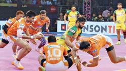 Patna Pirates raider Pradeep Narwal tackled by Puneri Paltan defenders in the Pro Kabaddi League Season 5 match at Babu Banarasi Das Indoor Stadium in Lucknow on Sunday.