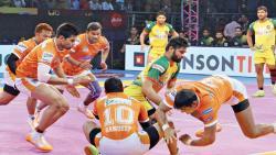 Patna Pirates raider Pradeep Narwal tackled by Puneri Paltan defenders in the Pro Kabaddi League Season 5 match at Babu Banarasi Das Indoor Stadium in Lucknow on Sunday.