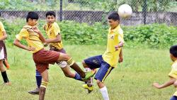Players of St Vincent's High School (in yellow and brown) in action against Mata Ramabai Ambedkar School on Saturday