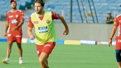 Kings XI Punjab player Andrew Tye plays football during the practice session at the MCA International Stadium on Saturday