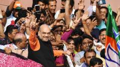 Amit Shah gestures to supporters during victory celebrations at BJP headquarters in New Delhi on May 23, 2019. AFP Photo