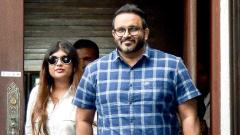 A file photo shows jailed former vice-president Ahmed Adeeb (R) walks along with his wife Mariyam Nashwa (L) as he returns to Maldives after receiving medical treatment from abroad at Velana International Airport in Male.