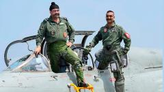 Air Chief Marshal BS Dhanoa and Wing Commander Abhinandan Varthaman pose for a photograph after a sortie on the MiG 21 jet, at Airforce Station, Pathankot, on Monday.