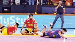 Delhi edge Gujarat to extend table-topping run