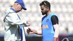 Indian team physiotherapist Patrick Farhart sprays the thumb of Virat Kohli after hurting it during a training session ahead of their Cricket World Cup match against South Africa at Ageas Bowl in Southampton, England on June 1, 2019. AP/PTI Photo