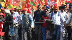 Farmers marching to Parliament stopped some distance away