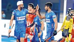 Mandeep Singh (left) celebrates scoring a goal with Varun Kumar.