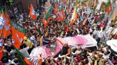 BJP crosses 300 mark, Cong bags 52 as counting nears end