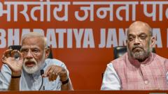 Prime Minister Narendra Modi speaks as BJP President Amit Shah looks on during a press conference at the party headquarter in New Delhi, on May 17, 2019. PTI Photo
