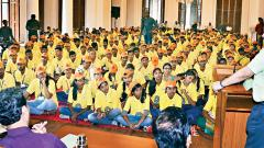 Divisional Commissioner Deepak Mhaisekar (R) addresses 500 students from SPPU before they leave for rehabilitation work in Sangli district.