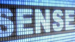 Sensex, Nifty end flat; rupee gains