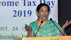 Sitharaman asks taxmen to deal firmly with evaders