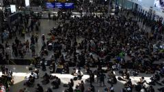 New airport rally as HK leader warns of 'path of no return'q