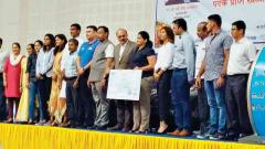Tawde exhorts medallists to help create new talent