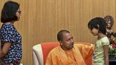Uttar Pradesh Chief Minister Yogi Adityanath interacts with the children of the private company executive Vivek Tiwari, who was allegedly shot at by a police constable, during a meeting with his family members in Lucknow on Monday.