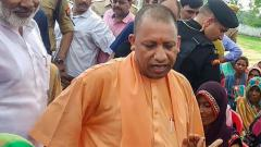 Adityanath meets families of Sonbhadra clash victims, accuses Cong of being 'anti-tribal'