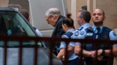 Jailed Australian Cardinal George Pell (C) is escorted to a white van as he leaves Victoria State's Supreme Court in Melbourne on June 5, 2019. AFP Photo