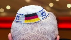 Picture taken on June 10, 2014 in Frankfurt am Main, Germany, shows a man wearing a Jewish kippa skullcap with the flags of Germany and Israel. dpa/AFP/Germany OUT Photo