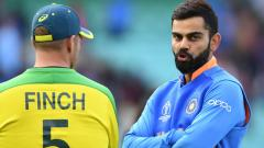 Virat Kohli speaks to Australia's captain Aaron Finch after victory in the 2019 Cricket World Cup group stage match between India and Australia at The Oval in London on June 9, 2019. AFP Photo