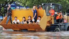 Rescue workers evacuate stranded residents with a bulldozer on a flooded street after typhoon Lekima hit Taizhou, Zhejiang province, China on Sunday.