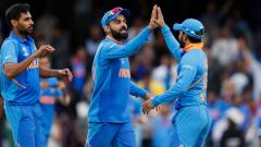 India's captain Virat Kohli celebrates with his players after victory in the 2019 Cricket World Cup group stage match between India and Australia at The Oval in London on June 9, 2019. AFP Photo