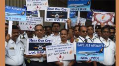 India's Jet Airways employees hold placards during a silent protest in Mumbai on May 8, 2019. AFP Photo