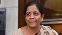 Newly-appointed Finance Minister Nirmala Sitharaman reacts emotionally as she takes charge of the Finance Ministry at North Block, in New Delhi, on May 31, 2019. PTI Photo