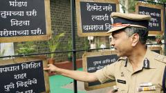 Pune Police Commissioner K Venkatesham reads a few of the signboards at the Commissioner's Office in Camp, on Friday