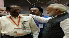 Prime Minister Narendra Modi interacting with ISRO Chief K Sivan, at ISRO office in Bengaluru on Saturday. Pic: ANI